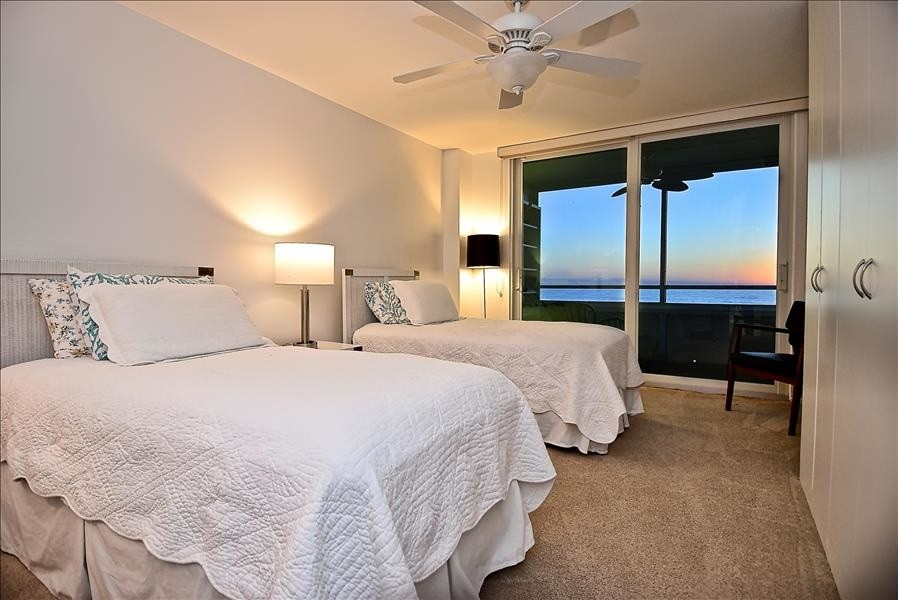 guest bedroom with lanai access