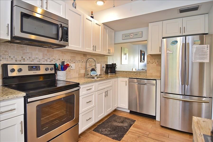 well stocked kitchen with updated appliances