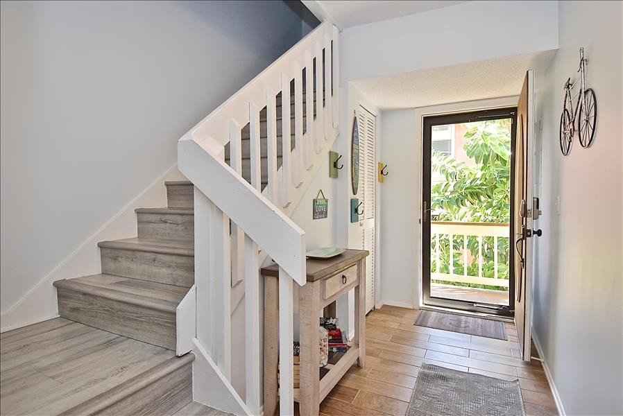 staircase up to the 2nd floor where bedrooms are located